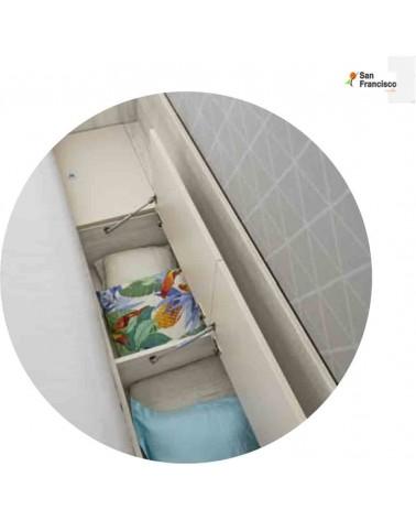 Cama alta con mesa inferior y escalera lateral